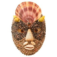 http://www.onantiquerow.com/products/seashell-mask-after-archimbaldo/1285