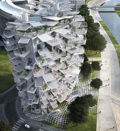"""An apartment building in France looks like a giant white pinecone. Balconies in every apartment unit! ' """"We wanted to preserve the sight as much as possible"""", says Manal Rachdi,  whose architect firm worked on the project with Sou Fujimoto and Nicolas Laisne Associates' Lifted from http://f-st.co/TpS9fCh"""