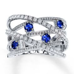 Round natural blue sapphires provide colorful contrast to interwoven rows of round diamonds in this contemporary ring for her. Styled in white gold. White Gold Sapphire Ring, Sapphire Jewelry, Sapphire Gemstone, Birthstone Jewelry, White Gold Rings, White Gold Diamonds, Sapphire Diamond, Round Diamonds, Rose Gold