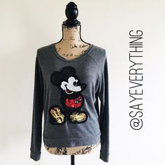 "Mickey Mouse Sequin Sweatshirt From the Happiest Place on Earth, this sequin Mickey Mouse sweatshirt will cheer up your wardrobe. Super soft pullover style with a loose fit. No missing sequins or threads – excellent condition.  Labeled a size XS but this does run big so I have it listed as a S. My dress form is about a size 6 for reference. Bust is 18"" across and the length is 21"". Sandals and phone case are not for sale. Thanks for looking! Disney Tops Sweatshirts & Hoodies"