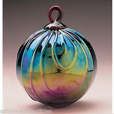 Glass-Eye-Studio-Classic-Ruby-Draped-Friendship-Ornament-Ball-148L. You CAN get the look of vintage carnival glass without being overcharged! $23.31 on eBay. Glass Eye produces some of the nicest ornaments I've ever found.