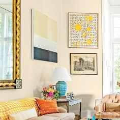 The 2015 Charlottesville idea House: In the Living Room, an 8-foot-tall, antique English Regency mirror above the sofa and a medley of paintings hung museum style fill the walls and keep eyes roving up.