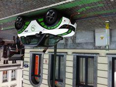 Coche eléctrico para alquilar en una calle de Bruselas, precio 7.00€ la hora