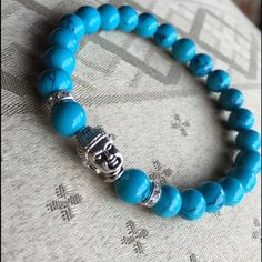 Turquoise Beaded Buddha Bracelet Stunning turquoise beaded Buddha bracelet. Natural agate stone 6mm beads with Buddha charm and crystal ring detail. Unique deep blue veining can be found throughout stone beading. Looks great alone or staffed with the other favorites. @bthereasap Jewelry Bracelets
