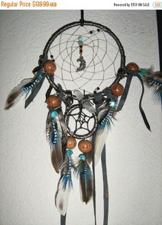 Dreamcatcher of the Black Moon with a Crystal Quartz Point Charm handmade by the Dreamcatcherman