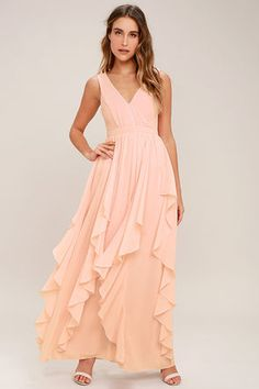 The Simply Sweet Blush Pink Maxi Dress is the dress you've been dreaming of! Lovely chiffon shapes a gathered, princess seamed bodice with a V-neck and back. A banded waist tops a flowy maxi skirt with flaring, ruffled godets. Hidden back zipper/clasp.