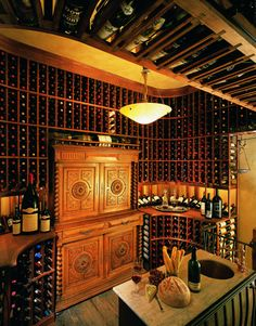 how BOUT this wine cellar? I'd live in here.. and be okay with waking up on the floor every morning.