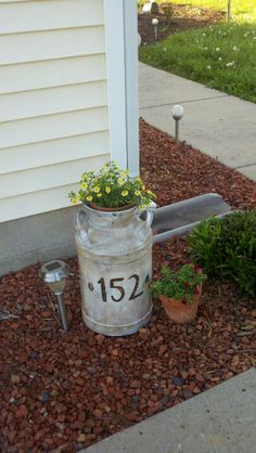 I painted  stained an old milk jug and address our house #... now delivery ppl will know which one is our home! Lol