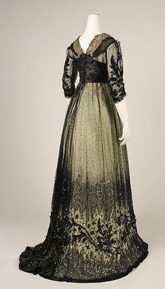 Three quarter back view.    Ball gown Date: ca. 1908 Culture: American Medium: silk, cotton, glass, metallic thread Dimensions: Length at CB: 56 in. (142.2 cm) Credit Line: Gift of Mrs. Arthur Valentine Bunnell, 1979 Accession Number: 1979.326