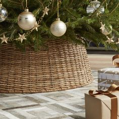 Shop Abaca Woven Tree Collar.  A modern alternative to the tree skirt, our tree collar neatly conceals the tree stand while enhancing the Christmas tree with the earthy charm of handwoven abaca fiber.