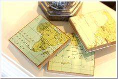 DIY map coasters {using free laminate floor samples from the hardware store + scrapbook paper or an old atlas}