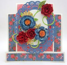 The blue flowers were made using the latest flower strip, Gardenia, then I added in the center roses and topped them off with the center from the Black Eyed Susan die. #cheeryld #pinkcloudscraps Dies used: Step Card (Set of 2) - B348; Swedish Spring Oval Frame - FRM135; Gardenia Strip - B339; Black Eyed Susan Strip - B338; Large Rose - B155; Medium Rose - B154; Miniature Rose - B152; Fanciful Flourish - B117; (Continued).. http://www.cheerylynndesigns.com