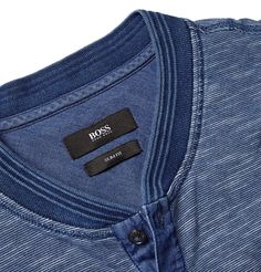 <a href='http://www.mrporter.com/mens/Designers/Hugo_Boss'>Hugo Boss</a>' Henley T-shirt will seamlessly slot into your casual repertoire. This mélange piece has been garment-washed for depth of colour and a soft handle. It will look particularly smart under a blazer with slim jeans and sneakers.