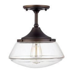 Illuminate your living room or master suite with this elegantly understated semi-flush mount, showcasing a glass shade and burnished bronze finish.