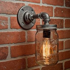 A handmade industrial chic sconce that is sure to add a truly charming accent to any home. This unique and re-imagined blend of metal pipe fittings and mason jars create a unique light that will surely add a warm and welcome atmosphere to your home or business. Features a quart size Ball mason