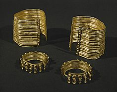 """HALLSTATT CULTURE JEWELRY  A pair of gold armlets and earrings from the tumulus """"La Butte"""", Sainte-Colombe, Burgundy, France, ca. 800 BCE."""