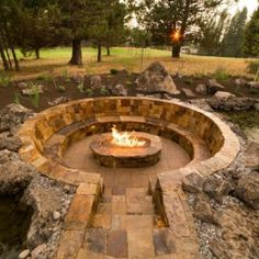 Garden. Circular stone seating with sunken fire pit, backyard garden, outdoor large garden, stone garden. Wonderfull sunken fire pit for outdoor home garden.