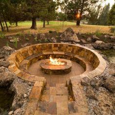 Garden. Circular stone seating with sunken fire pit, backyard garden, outdoor large garden, stone garden. Wonderfull sunken fire pit for outdoor home garden.