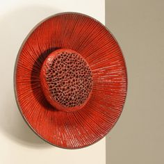 A ceramic wall lamp by Sejer, Denmark, 1960s in a perfect condition. The openings in the heart of the flower give a wonderful light and make it a beautiful object. Signed with makers mark.