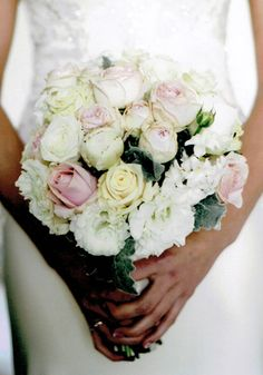 Rose and Lissianthus wedding bouquet from The Wild Orchid Echuca Victoria 0354806777. #rosebouquet #lissianthus #thewildorchid #weddingbouquet