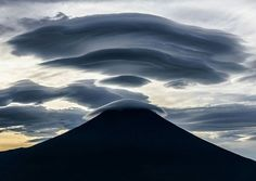 . Powerful cloud.  Photography by © (Takashi). Fuji is a treasure trove of mysterious shaped clouds. Various forms of clouds appear when a fast air current blows over the Mt Fuji. Just before sunrise they had become a huge cloud covering Mt. Fuji. The shadows of them in the backlight were the most powerful masterpieces. #mountain #fuji #weather #japan #cloud #sky