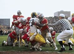 Ohio State safety Jack Tatum and defensive end Jim Stillwagon tackle a Michigan running back during a 1970 game between the two rivals. Ohio State Vs Michigan, Michigan Wolverines Football, Buckeyes Football, Football Memes, School Football, Ohio State University, Ohio State Buckeyes, Football Season, Football Team