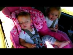 Baby fast asleep, until her favorite song comes on! I don't know who was funnier, the woken baby or the hysterical sister. Too cute
