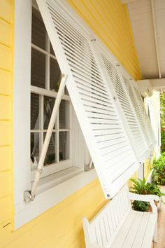 Bahama Impact Storm/Decorative Shutters - Tropical - Exterior - Chicago - Roll-a-way Storm and Security Shutters