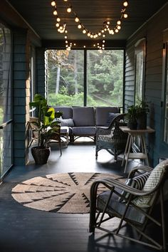 Moody porch.Shake siding and great lights
