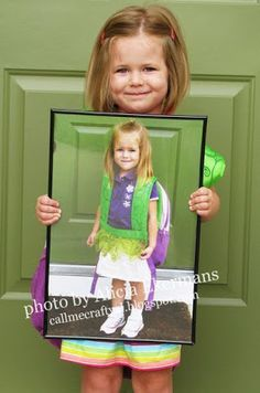 Last Day Of School Photo Idea: holding a framed picture of the first day of school photo {via: Our Little Coop}