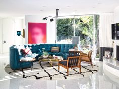 In this contemporary eclectic living room, a circular area rug, tufted curved sofa, and wooden chairs enhance one another. Custom Sofa, Custom Made Furniture, Eclectic Living Room, Living Room Sofa, Sofa Furniture, Outdoor Furniture Sets, Antique Furniture, Eclectic Design, Interior Design