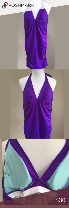 "Athleta Swim Dress Halter Purple Medium Tall Athleta Shirrendipity Halter Swim Dress.  COLOR-- ELECTRIC PURPLE Size medium tall Body: Nylon/Spandex. Lining: Polyester Breathable, sleek, stretchy Rated UPF 50+ Machine wash and line dry. Deep shirred V-neck, adjustable tie-halter neck, supportive underbust band Built-in shelf bra and brief, fully lined for no-see-through coverage Removable cups for extra coverage Body length in size medium Tall: 33"" Swim/ Surf/ Paddle Beach To Fro™ Athleta…"