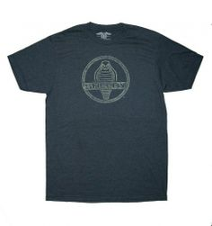 Shelby Logo Men T-Shirt  What does the Classic Shelby Logo Tee represent? Everything it took to revolutionize automotive performance from a small shop on Princeton Drive in the 1960s: long hours, no weekends off, no holidays, little sleep and an obsessive passion for speed.