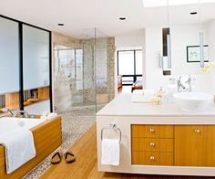 SPOTTED: that #pebble #stone look we love so much in this tranquil sun-filled bathroom!