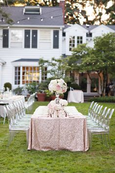 Sequinned pink linen. ghost chairs. pink and white flowers.