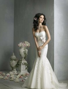 Love the cut and gentle lace details of this dress but probably minus the bow..