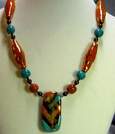 Kazuri Pendant Necklace in peacock and gold African beads