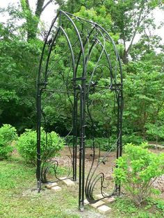 "Garden Arbor.  Karine Maynard's unique techniques in laying out her patterns for construction in the studio, were featured in the Artist Blacksmith Association of North America's publication called the ""Anvil's Ring"". Karine thinks like a painter... no surprise she 'shakes up' the blacksmith's age-old thinking by adding her traditional formal art training to such a unique trade!"