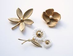 Gold Flower Brooches - 60s, 70s, 12K Gold - Lot of Vinage Flower Brooches - Daisies and Poppies. $52.00, via Etsy.