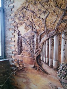 Sculpted tree and tromp l'oiel mural