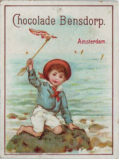 chromo chocolade besndorp -small boy in sailor suit on boulder waving spade with handkerchief as flag