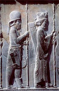 The Apadana Palace, northern stairway (detail) - ancient 5th Century BCE bas-relief shows a Mede soldier in traditional Mede costume (behind Persian soldier)