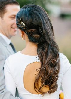 soft curls / pinned back to one side