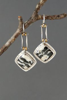 These earrings feature one of my favorite new stones called Zebra Stone, which comes from Utah. It is known for its bold black and white striping, which