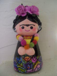 Frida Kahlo muñeca de papel mache   sold by Amepalas, via Flickr