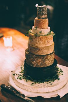 Cheese tower alternative wedding cake. Photography by Tom Biddle.