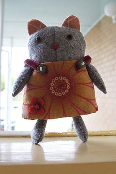 kitty in a sunday dress