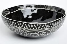 this looks very much like the etched gourd bowls I bought in Brasil several years ago - love them and love this!!