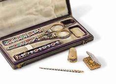 """Attributed to Jean-François Bautte & Cie. A gold and champlevé enamel sewing kit with """"mauresque"""" decoration in a fitted brown case with the initials H.D.G to the front, hinged to reveal a sewing set comprising an etui with one big and four smaller needles, a thimble, a pair of scissors with protective lid, a vinaigrette, a bodkin and a pencil with led; all with fine mauresque-style polychrome champlevé enamel decoration"""