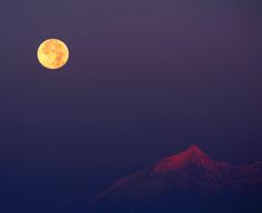 Hunter's Moon (the second Full Moon after the northern hemisphere autumnal equinox) over Rochemelon in the Italian Alps